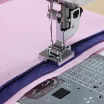Stopka do wszywania zamków krytych (do maszyn z szerokością ściegu 9 mm)