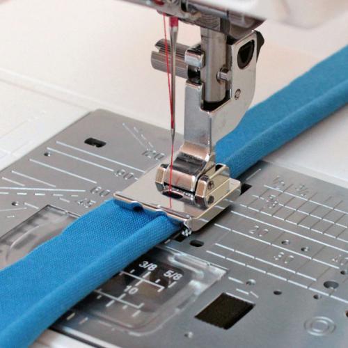 Stopka do wszywania wypustek (bizy) (do maszyn z szerokością ściegu 9 mm)