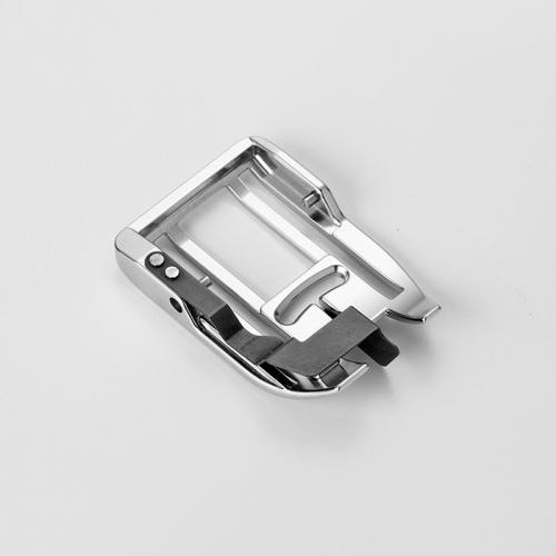 Płoza stopki z centralnym prowadnikiem do górnego transportu (do maszyn z szer. ściegu 9 mm)