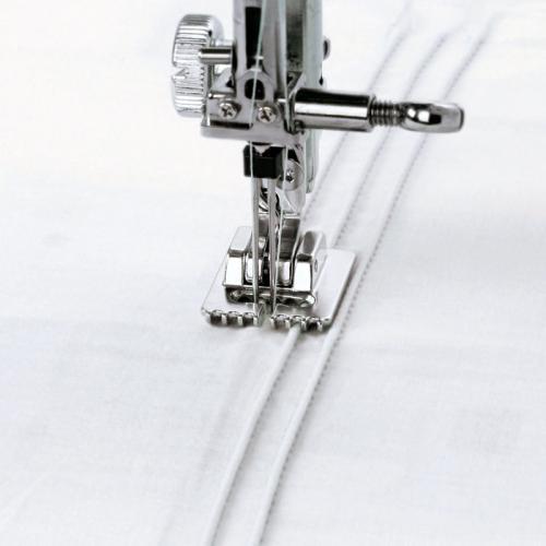 Stopka do wszywania kordu i cienkich wypustek (chwytacz wahadłowy)